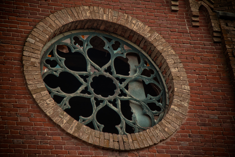restoration of a circular stained glass window
